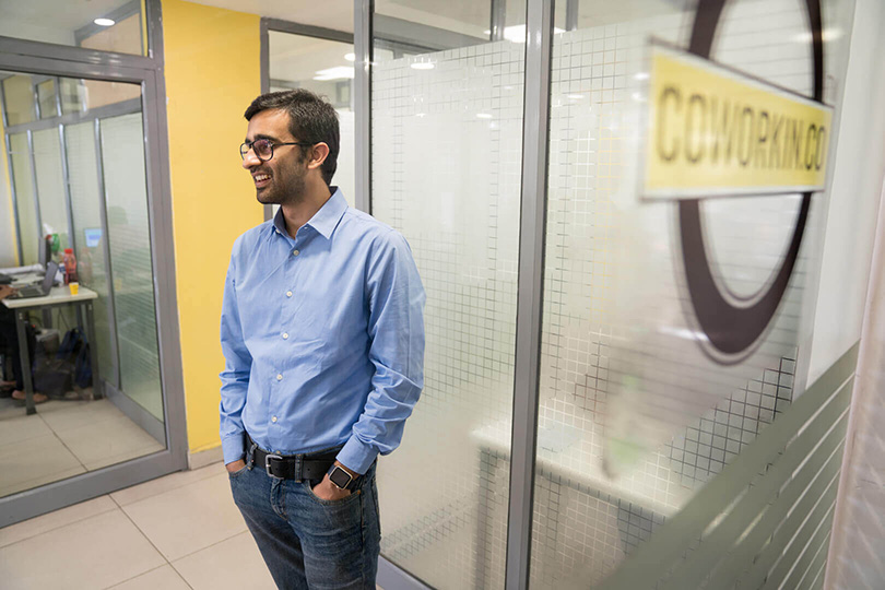 Yatin Thakur inside his CoWorkin office space