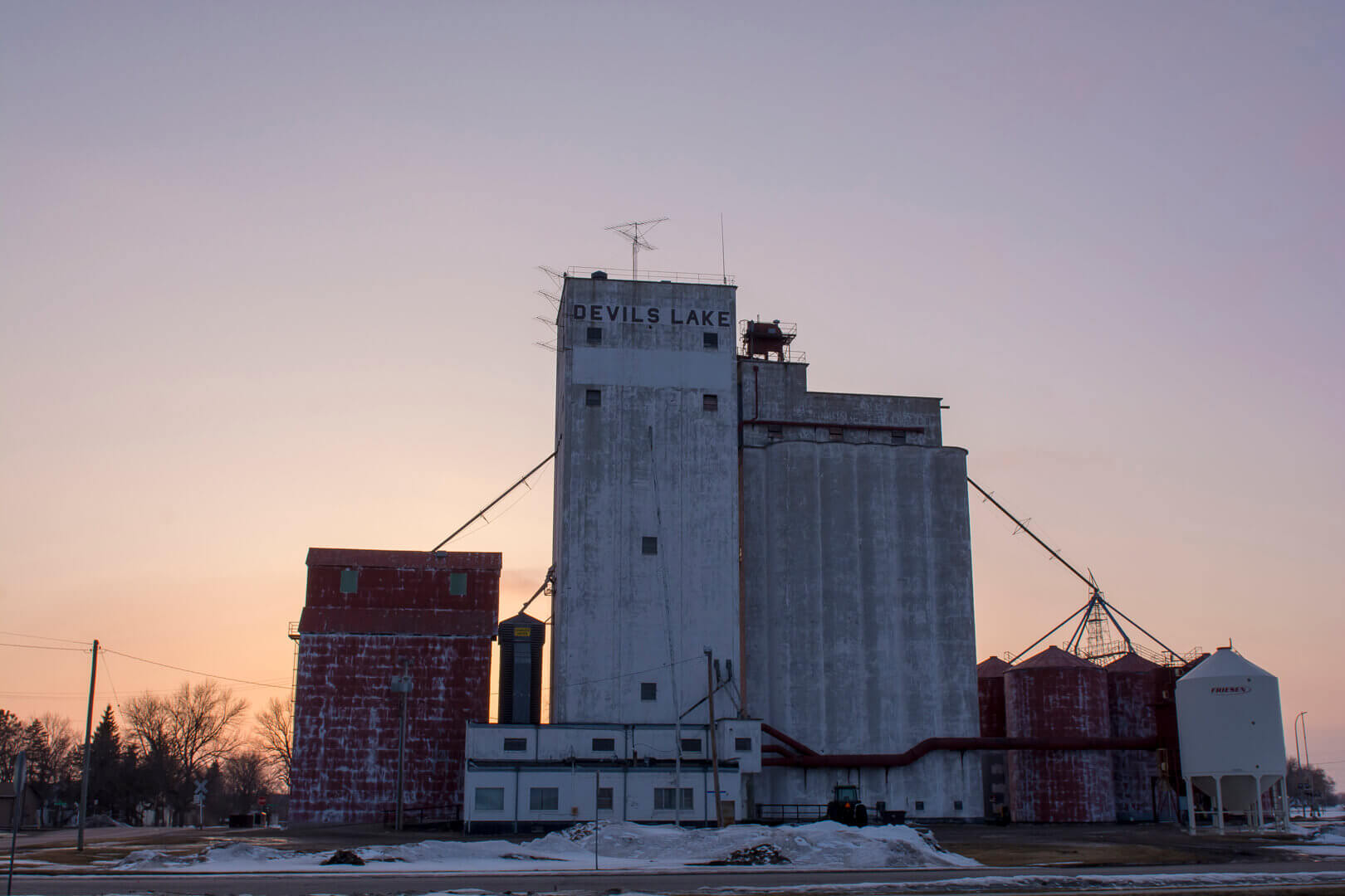 Grain silos during a winter sunset in Devil's Lake, North Dakota
