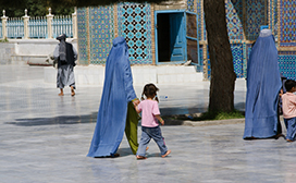woman walking with girl