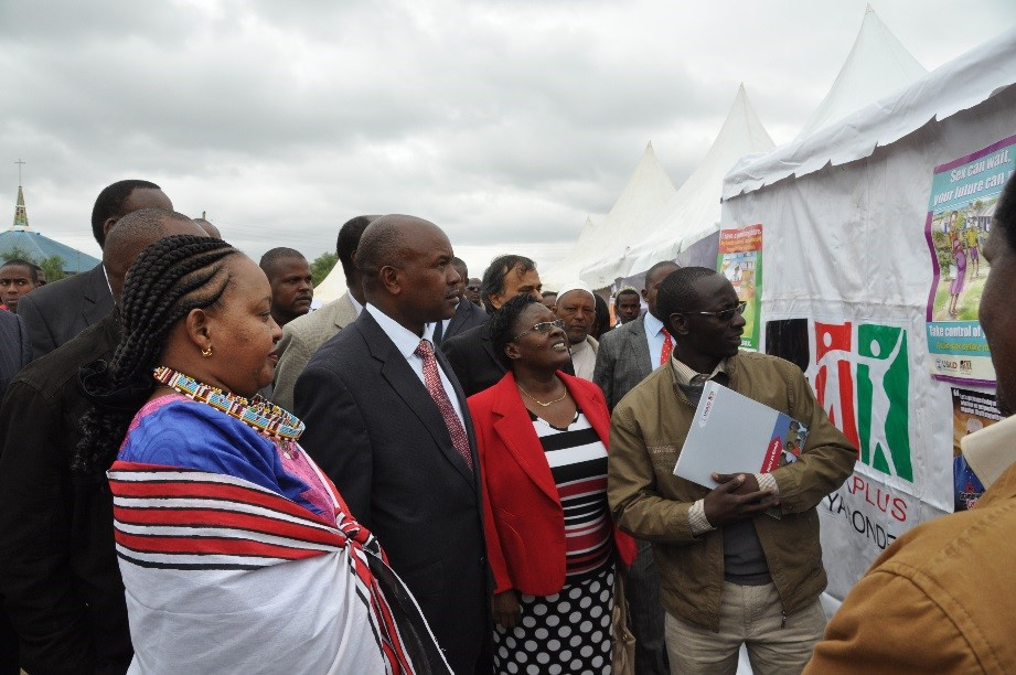 Kenya's Cabinet Secretary for Devolution and Planning Anne Waiguru (left) visits the APHIAplus Nuru ya Bonde booth during national World Population Day celebrations in Kajiado, Kenya.