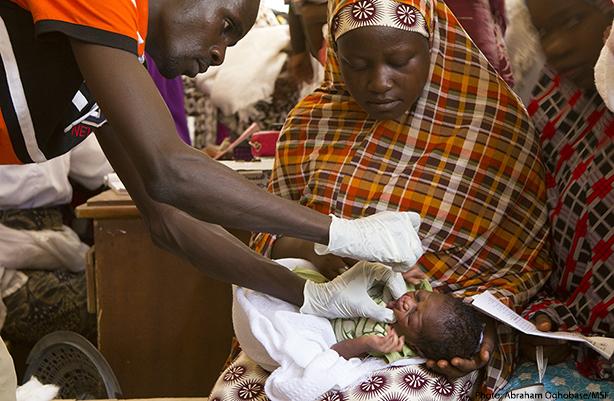 nurse treating baby