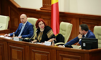 Pavel Filip, Prime Minister; Antonita Fonari, General Secretary of the National Council of CSOs; and Adrian Candu, Speaker of the Moldovan Parliament, open the second day of the annual Moldovan conference on cooperation between Parliament and civil society organizations.