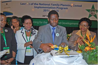 Hon. Prof. David Mwakyusa, Minister, Ministry of Health and Social Welfare, cuts the ribbon launching the new Tanzania National Family Planning Costed Implementation Program.