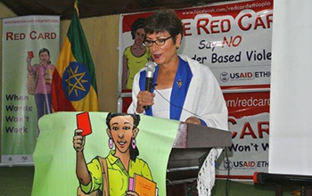 The U.S. Ambassador to Ethiopia, Patricia Haslach, speaks about the importance of the Red Card in preventing gender violence. FHI 360/Misti McDowell