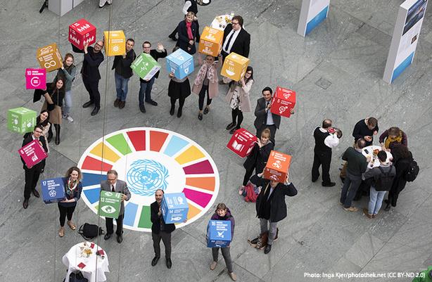 People holding SDG blocks