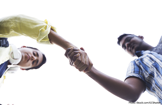 young men shaking hands