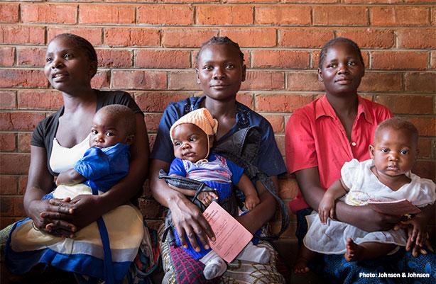 women holding babies