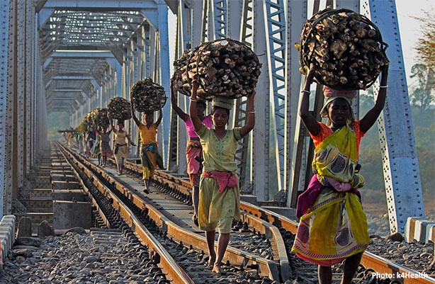 women carrying items on head