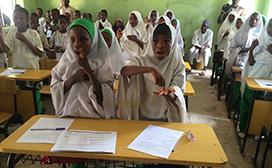 Class in Sokoto State, Nigeria, participates in an exercise from RANA project materials.