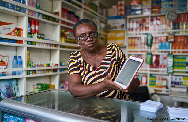 woman displaying tablet in pharmacy