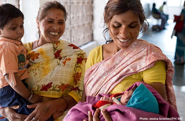 women holding baby