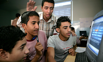young men using computer