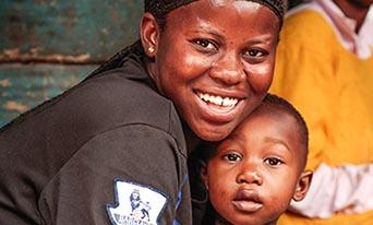 Mother hugging son in Kumasi, Ghana