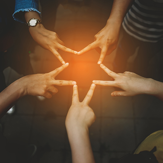 hands making the shape of a star
