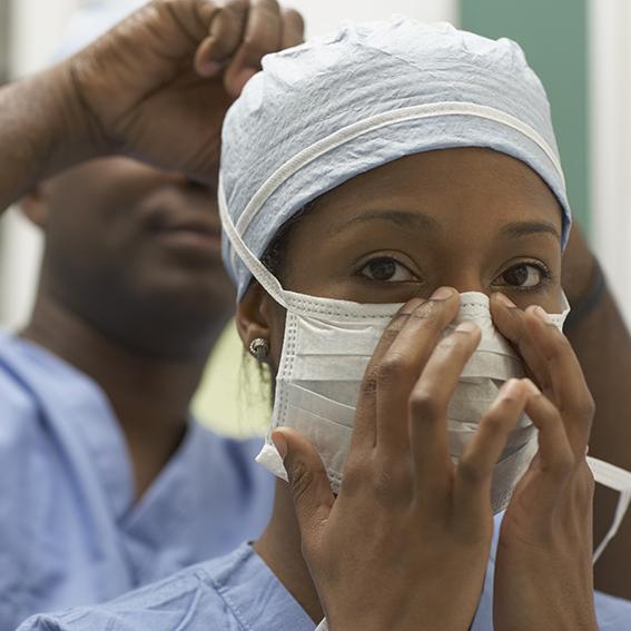 medical staff  putting on masks