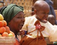 women smiling holding baby