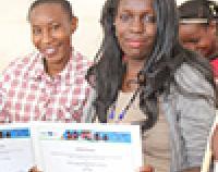 Hadija Abdi and Lorna Awuor receive their graduation certificate from Digital Opportunity Trust's entrepreneurship training program.