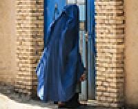 woman standing outside door