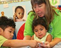 teacher helping children