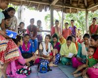 group of Nepali women in listening discussion and action groups