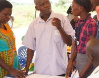 A community health worker shares ideas for improving health care services with his peers in northern Uganda's Oyam District.