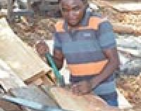 man working at carpentry business
