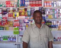 man behind counter in drug store