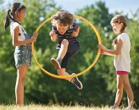 children playing outside with hula hoop