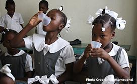 two haitian school girls taking NTD medication