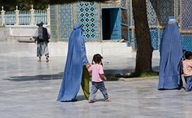 woman walking with girl