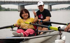 women rowing in boat