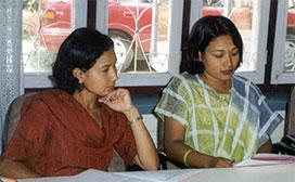 women discussing at table