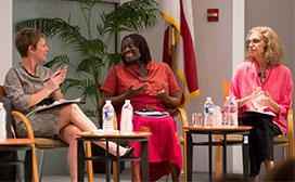 women talking as panel