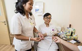 nurses helping patient