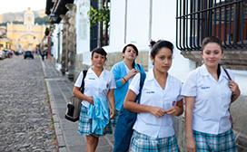 high school students walking down street