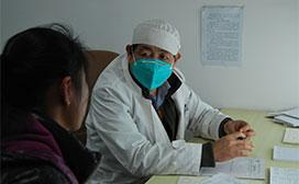 doctor wearing mask with patient