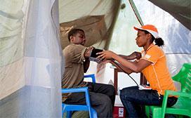 health worker reading blood pressure