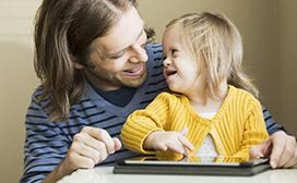 Man with girl and tablet