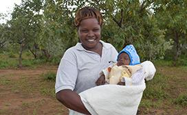 Felista Taila with her youngest child waiting to receive services at an outreach clinic in Baringo County, Kenya.