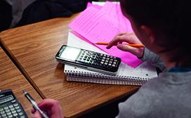 student using calculator