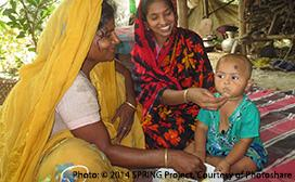 women feeding baby